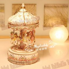 Carousel music box with changing light