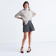 """A pleated mini skirt with lots of low-key shimmer and a grosgrain ribbon at the waist. A party no-brainer with a cami and tights. <ul><li>Full skirt.</li><li>16"""" long.</li><li>Viscose/polyamide.</li><li>Lined.</li><li>Machine wash.</li><li>Import.</li></ul>"""
