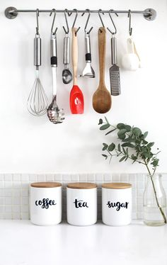 Kitchen storage rails are a common sight these days to keep utensils accessible and to avoid cluttered drawers. But what about those counter top storage containers that used to be found atop every grandmother's counter when you were a kid? Find some basic canisters and keep them clearly labeled—and looking cute enough to leave out on the counter or on a floating shelf—by hand lettering each one.