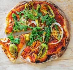 Squash Blossom Pizza | By: karen bianchi | Squash blossoms are all the rage at the spring/summer farmers markets. I will eat them any way I can. I especially love them stuffed with goat cheese, rolled in breadcrumbs and fried. Here is a pizza recipe with the much adored squash blossoms. | Via: food52.com