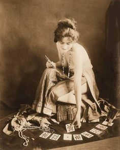 Google Image Result for http://chuckman1920sarcadecardbeauties.files.wordpress.com/2011/09/photo-for-arcade-card-exhibit-supply-company-woman-sitting-in-gypsy-like-outfit-with-cards-spread-on-floor-sepia-1920s.jpg%3Fw%3D510%26h%3D635