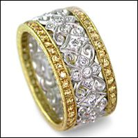 THIS is the engagement ring i want one day... except in rose gold/diamonds and silver, not yellow gold/yellow sapphires