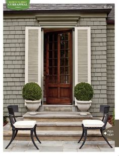 Gray shingles, white shutters, stone pavers.