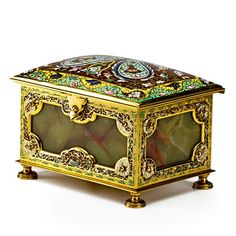 FRENCH ENAMEL AND ONYX JEWELRY CASKET Polychrome enamel decoration with onyx panels and tufted silk interior, ca. 1900