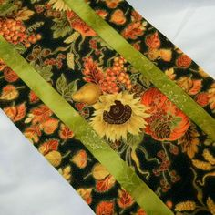 Fall or Autumn table runner - sunflowers on black with green trim