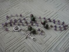 Handmade link rosary with amethyst and ruby pater beads. Papal crucifix.  https://www.facebook.com/FiorellinoDesigns/photos/a.911990205509195.1073741833.309862172388671/911991218842427/?type=3
