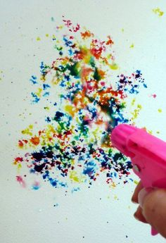 Fill up squirt guns with water and food coloring and wear white tshirts