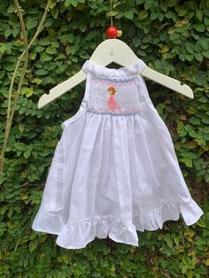 This lovely baby dress is a perfect wear for a summer evening. Pretty smocks with hand embroidered girl praying add to the liveliness of this pinny set . The dress comes along with matching white panty. With its super comfy thin fabric and lively hand embroidered designs, makes it a must have in your little one's wardrobe. Summer Evening, Cute Baby Clothes, Baby Shop, Little Babies, Cotton Dresses, Dress Collection, Baby Dress, Smocking, Dress Skirt