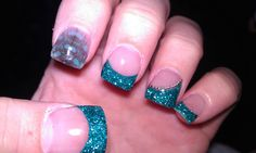 My nails and nail art idea: these were one of my favorite sets.  blue glitter tips, silver small balls with a curve on ring finger & feather under the acrylic on first finger.