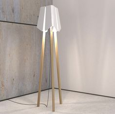 There are all great design of Lighting Simple Elegant Lighting for Flexible UseElomax Agencyhas introduced a new illumination design called Elagone lamp. The design is actually quite on marvelbuilding Luminaire Design, Lamp Design, Cool Lighting, Lighting Design, Luminous Intensity, Yanko Design, Wooden Lamp, Tripod Lamp, Decoration