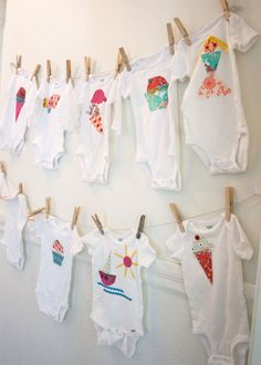 Baby Shower Onsie Station - onesies in different sizes and fabric/ricrack. Guests get to be creative and baby has cute onesies for a year! I would buy earth toned fabrics and baby animals to go with the woodland creatures theme, instead of the ice cream cones.