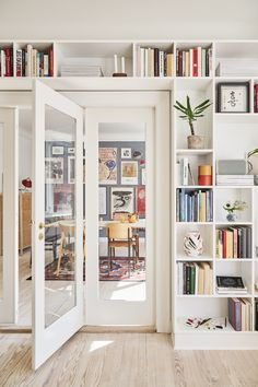 The perfect art wall and a built-in bookcase with French doors between ., The perfect art wall and a built-in bookcase with French doors between . - The perfect art wall and a built-in bookcase with French doors between … . Living Room Interior, Home Living Room, Living Room Designs, Living Room Decor, Living Room With Bookshelves, Living Room Shelving, Blue Living Room Walls, Nordic Living Room, Dining Room Storage