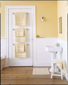 Save space and hang towel rack on door