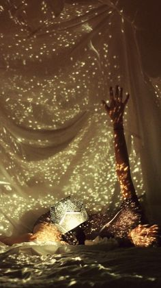 Fairy light- love it i think you could do it by punching holes in a can all different sizes and randomly spaced
