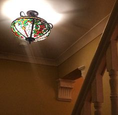 New, stained glass light. Wall colour is Farrow's Cream by Farrow and Ball.