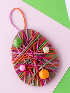 Just in time for Easter, kids can learn how to make a colorful Yarn Wrapped Easter Egg Craft at school or home. Yarn Wrapped Easter Egg Craft Kids of all ages will love this easy Easter Arts And Crafts, Easter Crafts For Kids, Spring Crafts, Craft Kids, Rabbit Crafts, Bunny Crafts, Easter Eggs Kids, Easter Activities, Crafts For Kids To Make