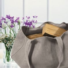 CANDY The work of our skilled artisans, has produced this gem of furniture: a comfortable, capacious and RESISTANT bag made of faux suede fabric where you can store the firewood near the fireplace, adding a touch of elegance to your house.