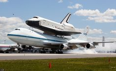 Safe landing: Enterprise landed at John F. Kennedy Airport just after 11.20 a.m. It is eventually going to make its new home in New York City at the Intrepid Sea, Air and Space Museum in New York City (4/12)
