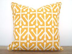 This geometric outdoor cushion cover is sewn with indoor /outdoor fabric from Premier Prints. Colors on this retro print include corn yellow and off