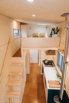 A walking platform next to the queen bed provides headroom so the owners can stand up next to the bed. At the end of the platform is a wardrobe with room for hanging clothes, plus there are storage cubbies and drawers that provide a partial privacy wall at the end of the bed. Tiny House Bedroom, Tiny House Loft, Tiny House Living, Tiny House Design, Tiny House On Wheels, Casa Loft, Mini Loft, Cute House, Tiny House Movement