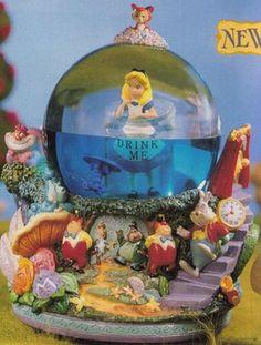 "Disney Snowglobes Collectors Guide: alice in wonderland ""Drink Me . Disney Home, Disney Dream, Disney Magic, Water Globes, Snow Globes, Princesa Ariel Da Disney, Disney Snowglobes, Disney Figurines, Disney Movies"