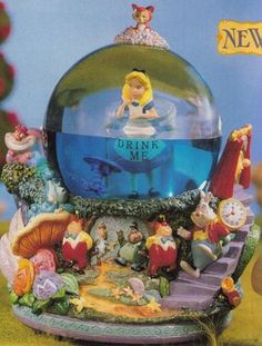 "disney snow globes | Disney Snowglobes Collectors Guide: alice in wonderland ""Drink Me ..."