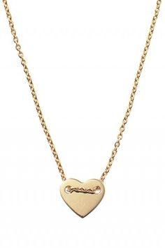 Stella & Dot's 'Ever After Necklace'...a simple and versatile gold heart is pierced by a gold vemeil chain.  $49