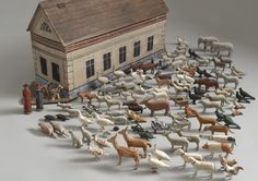 """Robert Young Antiques -- Delightful Naive Toy Noah's Ark Model  Of Unusual Design with Five Side Windows and Hinged Lid  Retaining Original Collection of 115 Animals and Two Figures  Hand Carved and Painted Wood  German Erzgebirge Region, c.1880  12.00"""" high x 28.75"""" wide x 7.75"""" deep"""