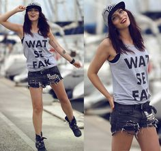 T-shirt, distressed shorts, studs, spikes, motorcycle boots