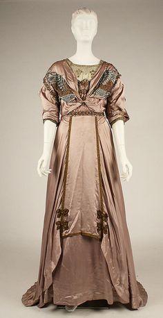 Dress, Evening  Date: 1907–1908  Culture: American  Medium: silk, metallic thread, floss  Metropolitan Museum of Art  Accession Number: 1979.150.4