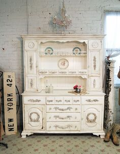 idea for my cabinet...Shabby Chic. love that brick wall...