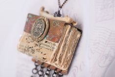 """Handmade Books... """"By Blood and Bone"""", detail  Experimental book. Paper, mica, copper, found objects. 5"""" x 2"""" x 1"""", 2014"""