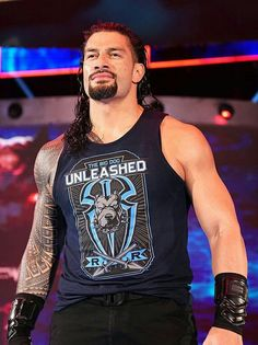Why Roman Reigns Always Wear that Vest on his Chest? Roman Reigns Shield, Wwe Roman Reigns, Roman Reigns Wwe Champion, Wwe Superstar Roman Reigns, Roman Reigns Superman Punch, Roman Empire Wwe, Roman Reigns Family, Dhoni Wallpapers, Wwe Wallpapers