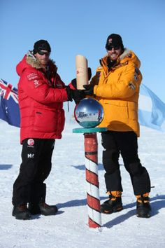 Prince Harry (left) and Heath Jamieson of Team Commonwealth at the pole, as they and their fellow adventurers reach the South Pole, as part of their Walking With The Wounded charity trek, 13.12.13.