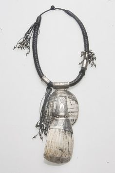 Necklace | Anne-Cécile Mesplet ~ Colliers d'Ailleurs/ Necklaces from Elsewhere.  Superb work of the Tuareg silversmiths on a Burmese shell, silver beads from Afghanistan and silver Tuareg beads on a leather Tuareg necklace.