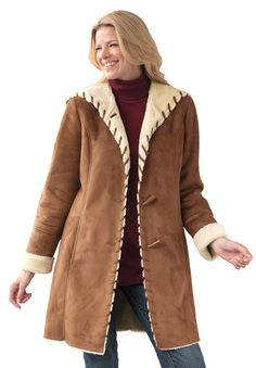 3a3c87e7574 Wrap yourself up for a comfortable outing in our plus size coat in faux  shearling. Woman ...
