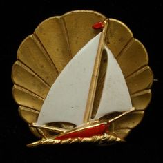 Vintage gold tone metal pin in the shape of a seashell with an enamel sailboat attached to it. This pin is in good to very good condition. The pin measures 1 x 1 Nautical Jewelry, Metal Pins, Sailboat, Hand Fan, Etsy Vintage, Sea Shells, Enamel, Ship, Sailing Boat