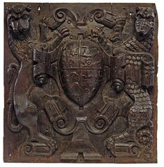 A HENRY VIII CARVED OAK RELIEF OF THE TUDOR COAT-OF-ARMS