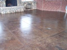 Concrete stain. good idea for a basement floor!