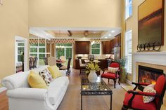 The Highlands II Model open floor plan, with fireplace, living room and kitchen - Meadowbrook Pointe Links & Spa.