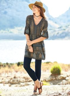Geometrics from a traditional Laotian textile are reinterpreted on our free-spirited tunic, jacquard knit in dusty shades of tan, chocolate and chambray pima. Bohemian chic over leggings, it has a contrast banded v-neck bodice, flounced elbow-length dolman sleeves and a seamed waist that releases in gathers to an A-line hem.