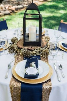 gold and navy wedding reception decor / http://www.himisspuff.com/navy-blue-and-gold-wedding-ideas/4/