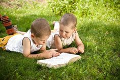 boys reads a book. People Photos