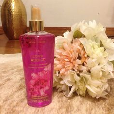 "Victoria's Secret Perfume ""Love Addict"" A new bottle of Victoria's Secret ""LOVE ADDICT"" fragrance mist An irresistible aroma of wild orchid and blood orange 8.4 fl oz NWOT Victoria's Secret Other"