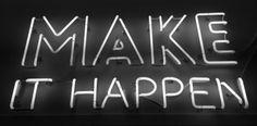 'Make it happen' Neon sign above the elevators at Eventbrite