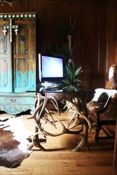 rustic Western office - cowhide and antlers