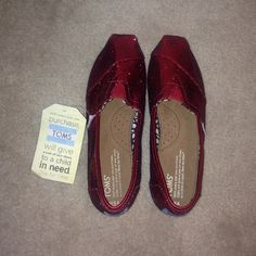 sparkly red TOMS BRAND NEW red sparkly TOMS. size 6.5 women TOMS Shoes Flats & Loafers