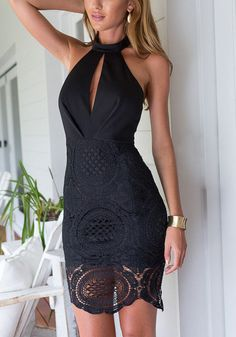This gorgeous black keyhole halter dress features mock neck design with back button detailing, open back and back zip closure in bottom. | Lookbook Store New Arrivals