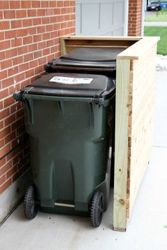 DIY trash enclosure- I'm thinking adding a gate and top would be easy enough. Trash Can Storage Outdoor, Garbage Can Storage, Outdoor Trash Cans, Hide Trash Cans, Trash Bins, Recycling Storage, Storage Bins, Trash Can Covers, Bin Shed