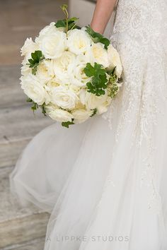 A white rose bridal bouquet | @iralippke | Brides.com